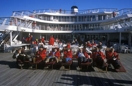 Travelers in deck chairs on deck of cruise ship Marco Polo, Antarctica