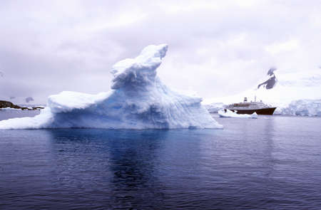 Cruise ship Marco Polo with glaciers and icebergs in Paradise Harbor, Antarctica