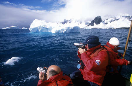 sightseers: Ecological tourists from cruise ship Marco Polo in inflatable Zodiac boat in Errera Channel at Culverville Island, Antarctica Editorial
