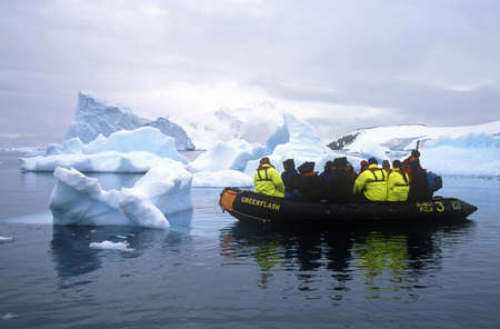 ice floes: Ecological tourists in inflatable Zodiac boat in Paradise Harbor, Antarctica