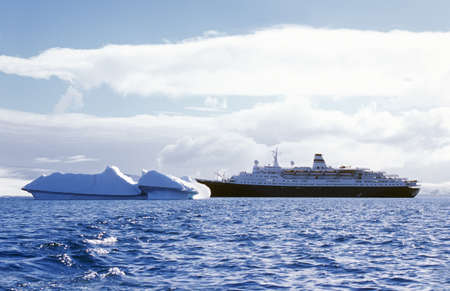 Cruise ship Marco Polo with glaciers and icebergs in Errera Channel at Culverville Island, Antarctica