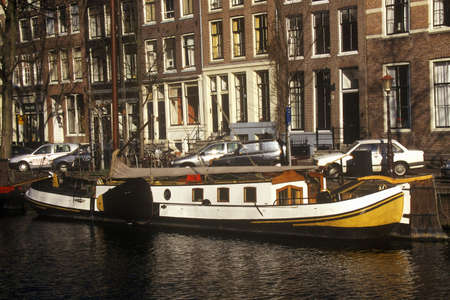 abodes: Canal and houseboat in Amsterdam, Holland