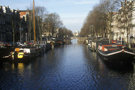 abodes: Canals and houseboats in Amsterdam, Holland Editorial
