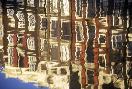 abodes: Reflections of Buildings In A Canal in Amsterdam, Holland Editorial