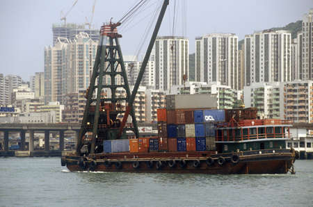 photographies: Freighter ships and Hong Kong cityscape Editorial