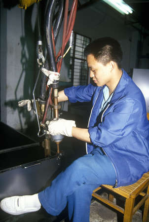 Factory workers at Shanghai Shangling Electric Appliances Company, Ltd., in Shanghai, Peoples Republic of China
