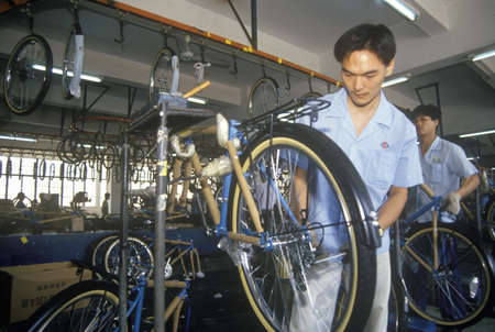 Factory workers at China Bicycle in Shenzhen in Guangdong Province, Peoples Republic of China