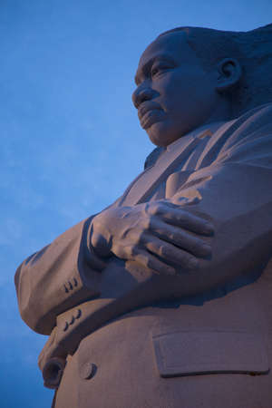 martin luther king: The Martin Luther King Jr. Memorial at dusk with deep blue sky, a monument to civil rights leader. Located in Washington, D.C., the memorial is the 395th National Park, and is located on the National Mall on the Tidal Basin.  Stock Photo