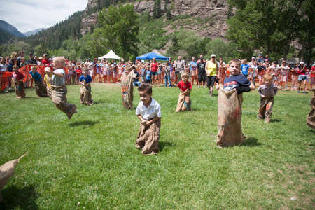 Young boys compete in Three Legged race in Ouray, Colorado, July 4, Indpendence Day annual picnic event
