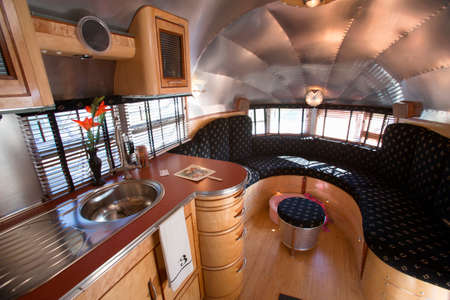 airstream: Interior view of 1930s Art Deco Airstream Trailer at Vintage Trailers and Campers, the 4th Annual Vintage Trailer Bash, Flying Flag RV Resort, Buellton, California  Editorial