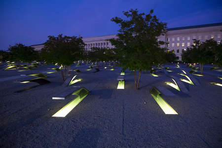 The Pentagon Memorial features 184 empty benches at dusk, a Memorial to commemorate the anniversary of the September 11, 2011 attacks, in Arlington VA., Washington, DC, USA. Editorial