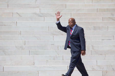 congressman: Georgia Congressman John Lewis waves at the  National Action to Realize the Dream march and rally for the 50th Anniversary of the march on Washington and Martin Luther Kings I Have A Dream Speech, August 24, 2013, Lincoln Memorial, Washington, D.C.