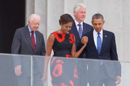 President Barack Obama, First Lady Michelle Obama and former presidents Jimmy Carter and Bill Clinton arrive for the ceremony to commemorate the 50th anniversary of the March on Washington for Jobs and Freedom August 28, 2013 in Washington, DC.   Redakční