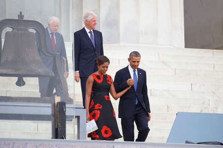 former: President Barack Obama, First Lady Michelle Obama and former presidents Jimmy Carter and Bill Clinton arrive for the ceremony to commemorate the 50th anniversary of the March on Washington for Jobs and Freedom August 28, 2013 in Washington, DC.   Editorial