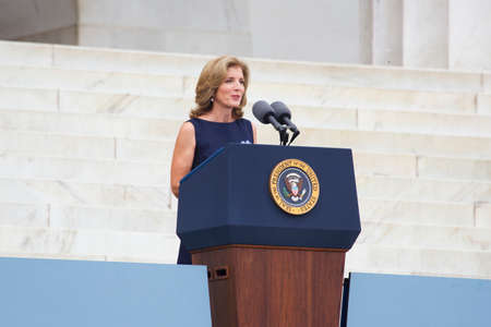 ambassador: Caroline Kennedy, Ambassador to Japan and daughter of President John F. Kennedy, speaks under an umbrella during the Let Freedom Ring ceremony at the Lincoln Memorial August 28, 2013 in Washington, DC, commemorating the 50th anniversary of Dr. Martin Luth