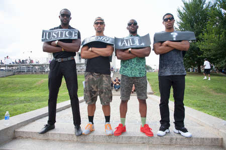 justice for all: Justice for All? - Four African American males pose at the National Action to Realize the Dream march and rally for the 50th Anniversary of the march on Washington, August 24, 2013, Lincoln Memorial, Washington, D.C.