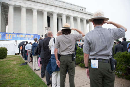 national parks: National Parks Rangers salute at the Let Freedom Ring ceremony at the Lincoln Memorial August 28, 2013 in Washington, DC, commemorating the 50th anniversary of Dr. Martin Luther King Jr.s I Have a Dream speech.