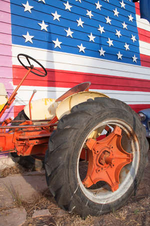 Antique Red tractor and US Flag, Seligman, Arizona, Route 66