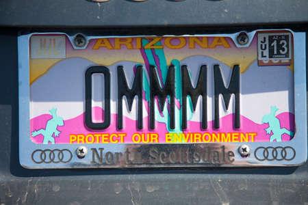 license plate: Arizona License plate saying OMMMM