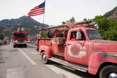 incidental people: Antique Ridgway firetruck drives drives in July 4 Independence Day Parade, Ouray, Colorado