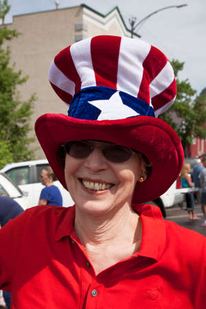 Woman smiles with Uncle Sam hat on July 4 Independence Day Parade, Ouray, Colorado