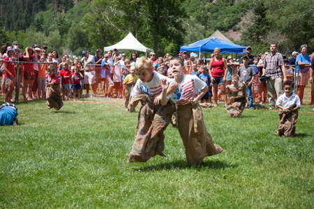 legged: Young boys compete in Three Legged race in Ouray, Colorado, July 4, Indpendence Day annual picnic event