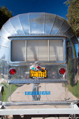 escapism: Vertical exterior view of vintage Airstream Trailer at the 4th Annual Vintage Trailer Bash, Flying Flag RV Resort, Buellton, California