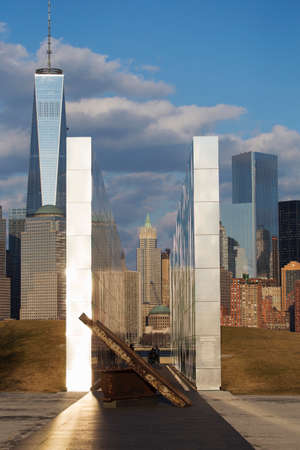 wtc: Empty Sky: Jersey City 911 Memorial at sunset shows iron beam from W.T.C., New Jersey, USA Editorial