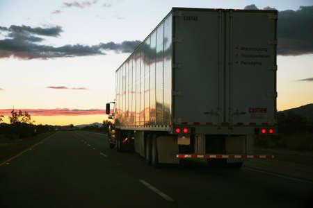 18-wheeler semi-truck drives west on Interstate 10, near Palm Springs, California, USA Stock Photo