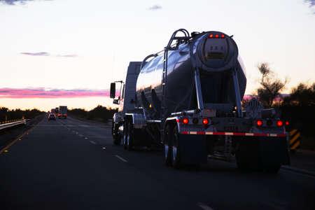 18-wheeler semi-truck tanker drives west on Interstate 10, near Palm Springs, California, USA Stock Photo