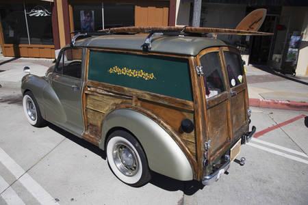 station wagon: Mini woody station wagon with surf board, Ventura, California, USA