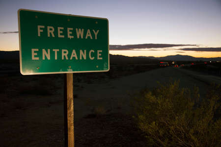 western script: Freeway Entrance road sign at sunset, onto Interstate 10, California, USA Stock Photo