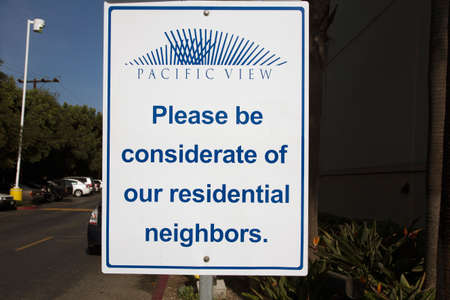 considerate: Please be considerate of residential neighbors, road sign, Ventura, California, USA Stock Photo