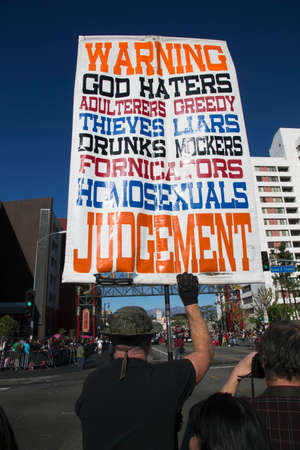 unfairness: Sign for Christian extremist, anti-homosexual and atheists, hold sign, Chinese New Year, Los Angeles, California, USA