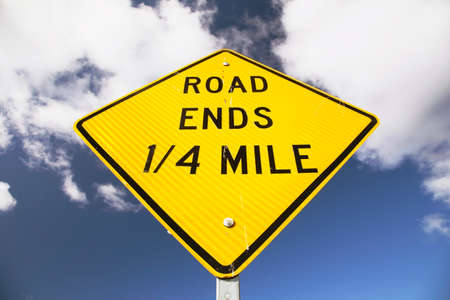 stating: Sign stating Road Ends in 14 mile Stock Photo
