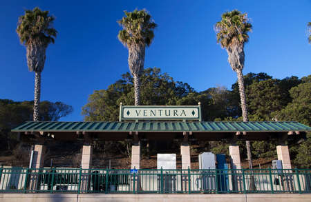 three palm trees: Amtrak train stop with three palm trees, Ventura, California, USA Stock Photo