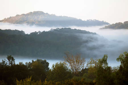 surrounds: Marine layer surrounds mountains in fog and clouds, Oak View, California, USA Stock Photo