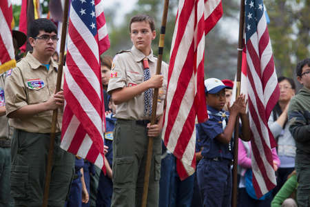 solemn: Boyscouts display US Flag at solemn 2014 Memorial Day Event, Los Angeles National Cemetery, California, USA Editorial