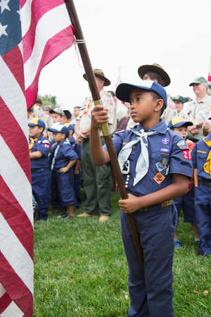 solemn: Cubscout display US Flag at solemn 2014 Memorial Day Event, Los Angeles National Cemetery, California, USA