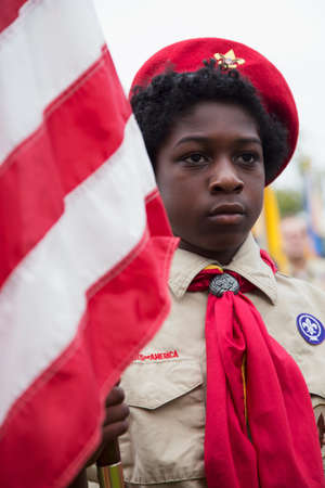 only one teenage boy: African American Boyscout display US Flag at solemn 2014 Memorial Day Event, Los Angeles National Cemetery, California, USA
