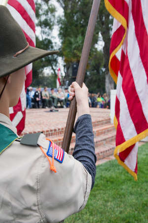 only one teenage boy: Boyscouts display US Flag at solemn 2014 Memorial Day Event, Los Angeles National Cemetery, California, USA Editorial