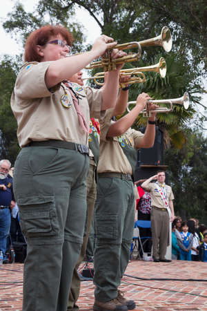 three people only: Trumpets play Taps at 2014 Memorial Day Event, Los Angeles National Cemetery, California, USA
