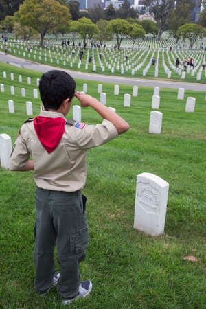 only one teenage boy: Boyscout salutes at one of 85, 000 US Flags at 2014 Memorial Day Event, Los Angeles National Cemetery, California, USA Editorial