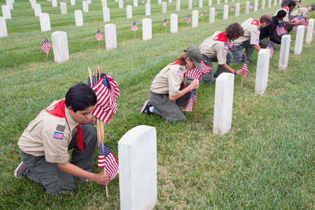 only boys: Boyscouts placing one of 85, 000 US Flags at 2014 Memorial Day Event, Los Angeles National Cemetery, California, USA