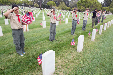 only boys: Boyscouts saluting at one of 85, 000 US Flags at 2014 Memorial Day Event, Los Angeles National Cemetery, California, USA Editorial