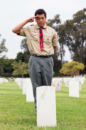 only boys: Boyscout saluting at one of 85, 000 US Flags at Annual Memorial Day Event, Los Angeles National Cemetery, California, USA