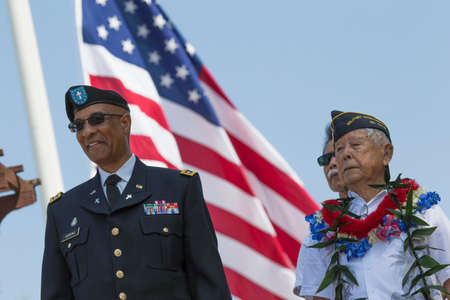 Ret. Milton S. Herring left and Ret. Lt. Yoshito Fujimoto and US Flag, Los Angeles National Cemetery Annual Memorial Event, May 26, 2014, California, USA Banco de Imagens - 44266786