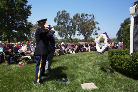 korean ethnicity: Unification Advisory Council saluting during Los Angeles National Cemetery Annual Memorial Event, May 26, 2014, California, USA
