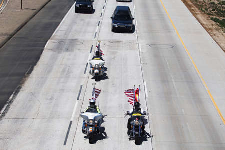 honoring: Patriot Guard Motorcyclists honoring fallen US Soldier