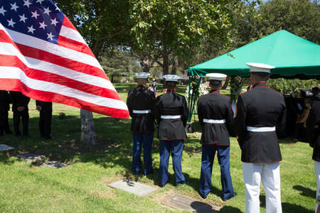 at ease: US Marines at ease at Memorial Service for fallen US Soldier